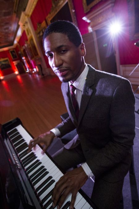Jon Batiste is hard to pin down. He's good at more than one instrument, percussion, piano, B3, whatever's at hand. He comes from a strong mu