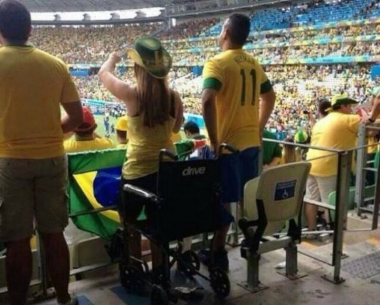 Police investigating wheelchair-bound World Cup fans pictured standing