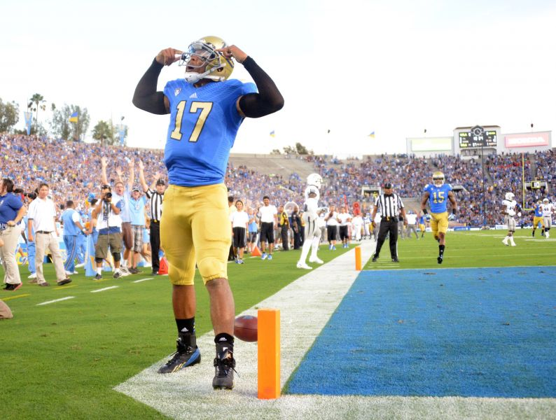 UCLA QB Brett Hundley gets advice from Chargers Philip Rivers