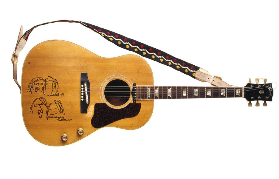 "John Lennon's guitar used during the ""bed-ins for peace."""
