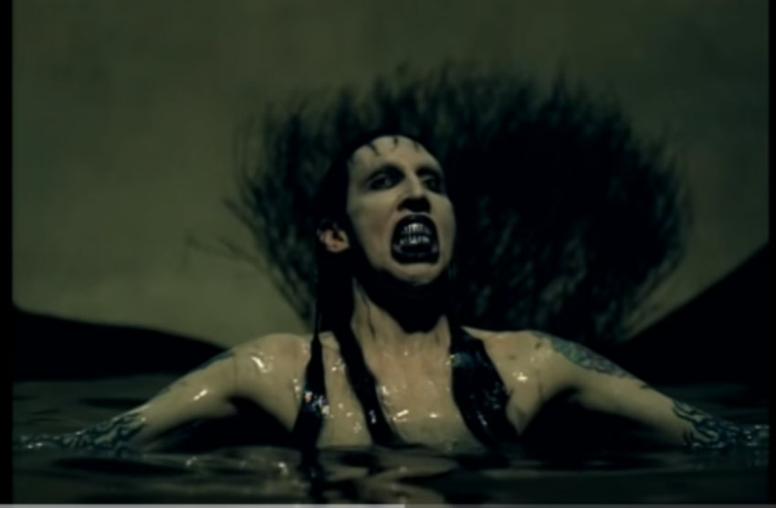 Marilyn Manson effortless marries the grotesque with beauty in his music videos.