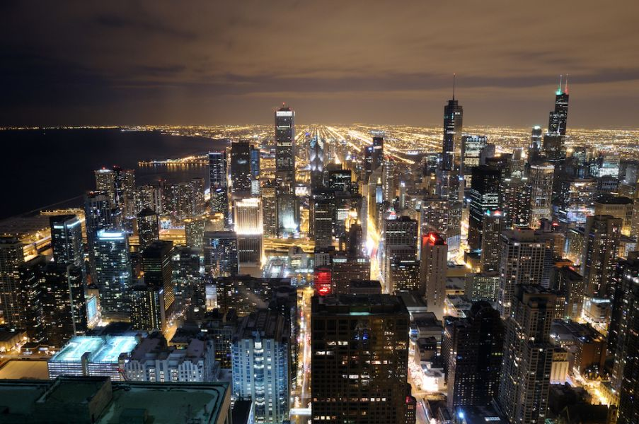 Who could guess there are two MLB stadiums hiding in the Windy City night?