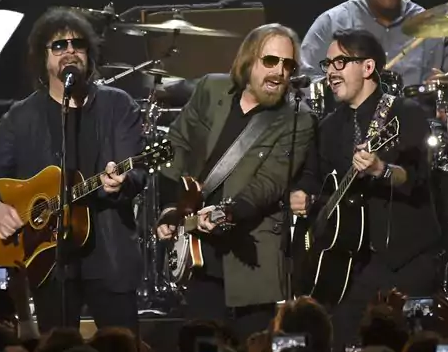Tom Petty performs alongside his former Traveling Wilburys bandmate Jeff Lynne at the MusicCares Gala on Friday.