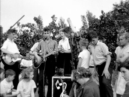 John Lennon and the Quarrymen perform at the Woolton Garden Fete on July 6, 1957, the day Lennon and Paul McCartney first met.