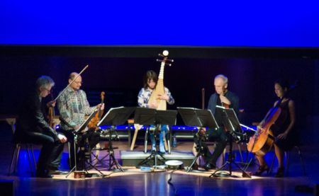 Wu Man (center) and Kronos Quartet onstage at the DeBartolo Performing Arts Center, Notre Dame University, South Bend, Ind. Saturday March 2