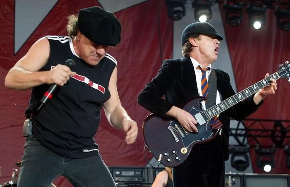 Brian Johnson (L) and Angus Young of the Australian rock group AC/DC perform during the SARS relief concert held at Downsview Park July 30,