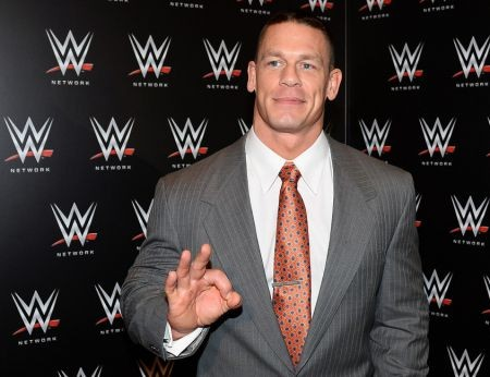 """John Cena has a few great hand gestures. He does one where he waves in hand in front of his face to signal """"you can't see me,"""" but his most"""