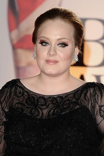 Adele ties Beatles record with two titles in top five UK singles & album charts