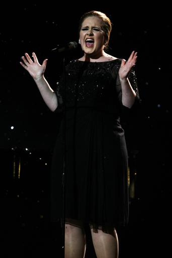 Adele's '21' debuts at No 1 on Billboard charts; Welcome to America