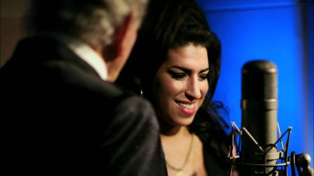 Tony Bennett appears with Amy Winehouse's parents at the Grammy Awards