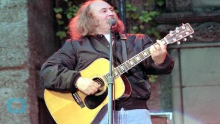 Blinded by the sun, David Crosby hits jogger with his car