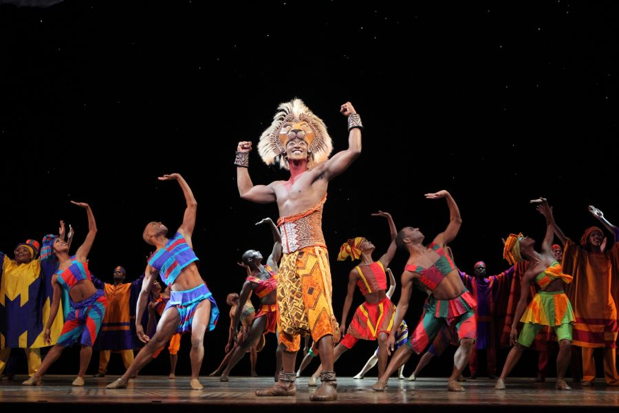 "Jelani Remy as ""Simba"" and the ensemble in ""He Lives in You"" from THE LION KING National Tour. Disney"
