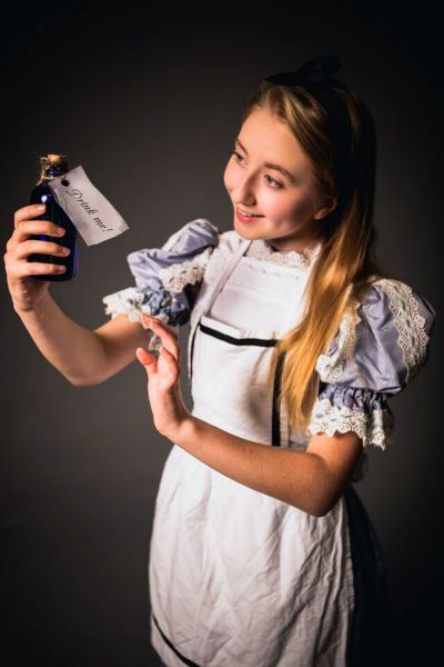 """Julia Wyman prepares for her role as Alice in TMP Family Theaters' """"Alice in Wonderland."""""""