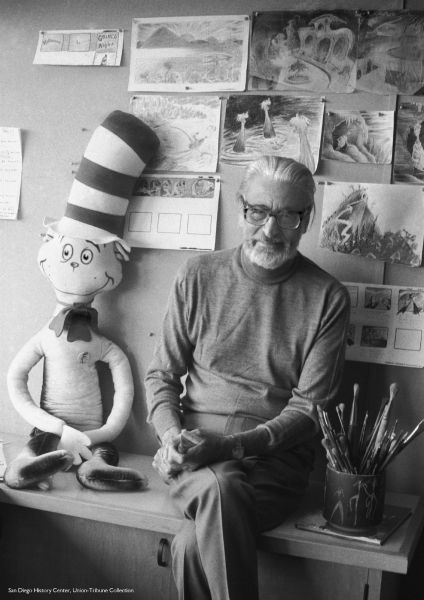 Here sits Theodor Geisel, aka Dr. Seuss, 1976 with one of his most beloved creations, Cat in the Hat.