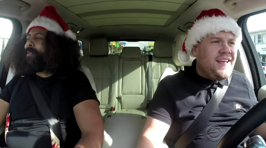 James Corden and Reggie Watts get ready to carol their hearts out