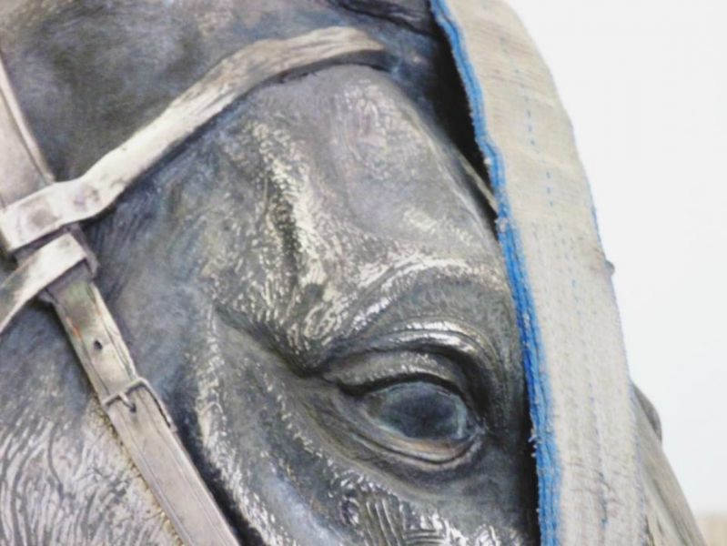 """Before its unveiling: A glimpse of """"Along the Trail"""" by Donald L. Reed, a sculpture of President Ronald Reagan and his horse El Alamein."""