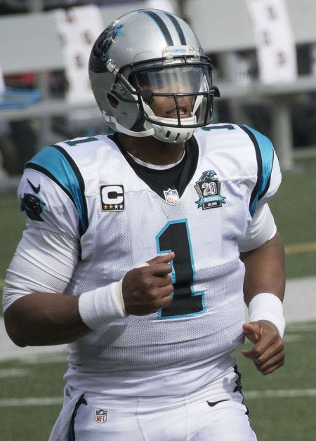 Cam Newton, not wearing a tie, presumably to the chagrin of Ron Rivera.