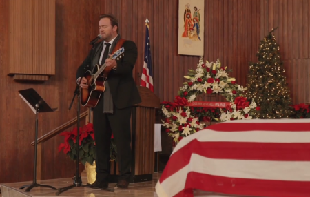 "Lee Brice performs ""Go Rest High on That Mountain"" to honor Maj. Troy Gilbert."