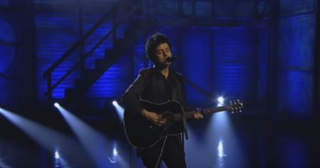 Armstrong performed solo acoustic on Conan Wednesday.