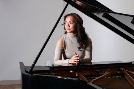 Lynn Yew Evers prepares to play her upcoming concert.