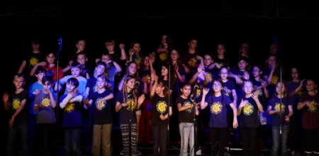 "The members of the Barton Hills 5th grade Choir perform the Grateful Dead's hit song, ""Touch of Grey."""