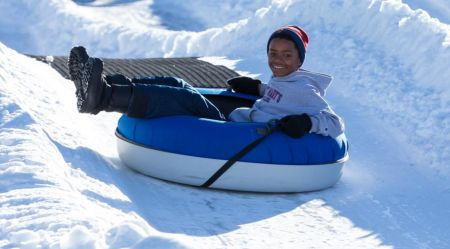 Tubing is a great way to introduce your kids to winter sports