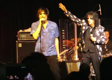 Jim Carrey joins Alice Cooper on stage during Cooper's NYC benefit concert in Hawaii.