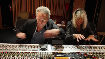 Fleetwood Mac members Lindsey Buckingham and Christine McVie play around in the recording studio while working on their upcoming duet album.