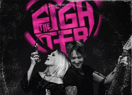 "Keith Urban and Carrie Underwood team up for ""The Fighter."""
