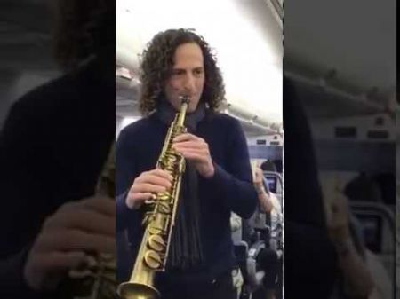 Kenny G plays impromptu show on an airplane to raise money for Cancer