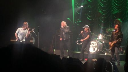 Watch: Brian Johnson returns to the stage with Robert Plant and Paul Rodgers after hearing loss diagnosis