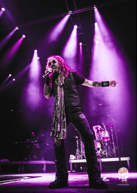 The Dead Daisies singer John Corabi spoke with AXS on Sunday night about the band's new live CD/DVD and upcoming tour, his time in Motley Cr