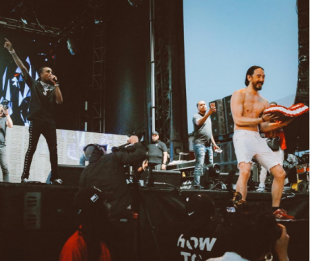 Steve Aoki onstage with Migos