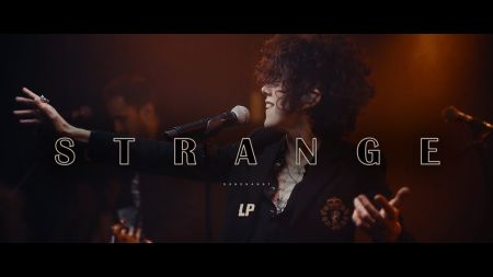 LP releases powerful performance video of 'Strange'