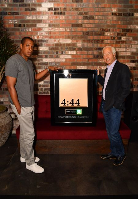 Jay-Z being presented with his platinum plaque for4:44by RIAA CEO and Chairman Cary Sherman.
