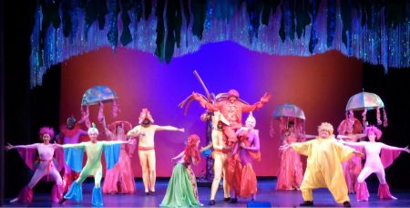 "Isaiah Parker and the ensemble cast of Tacoma Musical Playhouse's ""The Little Mermaid."""