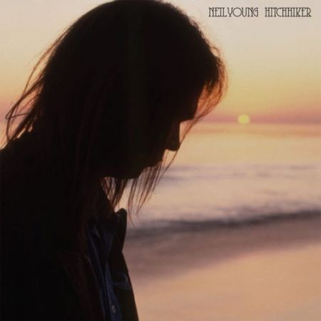 Neil Young will release a pair of never-before-heard tracks on his upcoming acoustic album, Hitchhiker.
