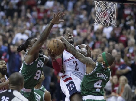 John Wall drives to the hoop against the Boston Celtics during the Wizards' 2017 playoff run.