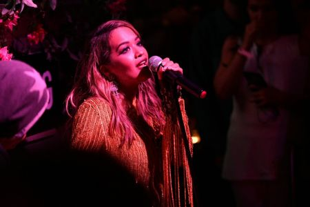 Los Angeles, CA - Aug. 17: Rita Ora stuns the crowd with an acoustic performance at the PrettyLittleThing x Olivia Culpo launch party in Hol