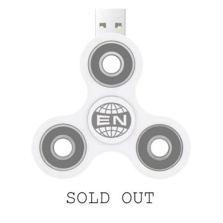 Arcade Fire actually sold their customized fidget spinners at their 2017 tour opener in Quebec City on Tuesday night, with sales proceeds go