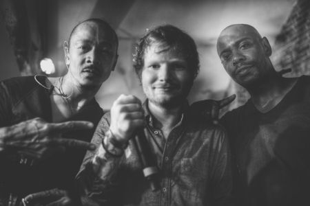 Frederic Yonnet (l.), Ed Sheeran (c.) and Dave Chappelle (r.) pose for a photgraph during a 2015 aftershow in London.