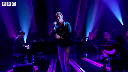 "Josh Homme performs ""Villains of Circumstance"" on Later... with Jools Holland alongside a string quartet."