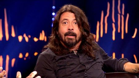 Dave Grohl helps an injured Foo Fighters fan by gifting her his shoe