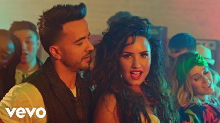 Luis Fonsi and Demi Lovato drop colorful 'Échame La Culpa' music video