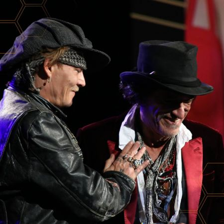 Johnny Depp joins Joe Perry onstage last year at the 2017 NAMM TEC Awards. This year's annual TEC Awards will take place during The NAMM Sho