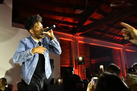 "LOS ANGELES, CA - June 20: KYLE performs ""iSpy"" for a packed house during the boohooMAN launch party in Hollywood on Tuesday night."