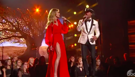 Tim McGraw and Faith Hill perform at the 51st CMA Awards.