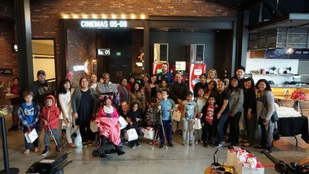 BUENA PARK, CA - MARCH 24: Over 50 children and families from the Blind Children's Learning Center gather at the CGV Buena Park 8 in Orange