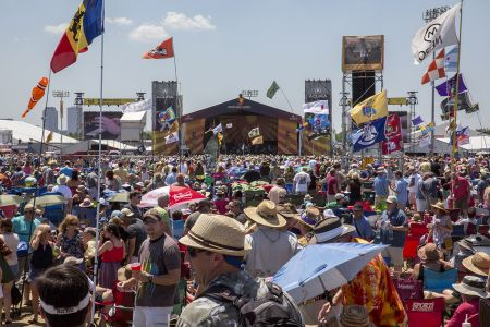 Music fans flock to the Acura stage in anticipation of the day's headline act.