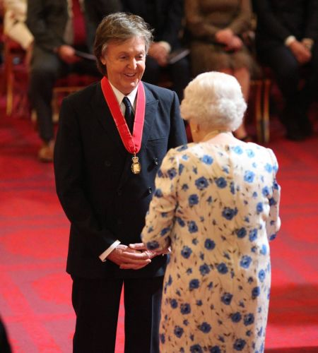 Sir Paul McCartney is awarded the Companion of Honour by Queen Elizabeth II